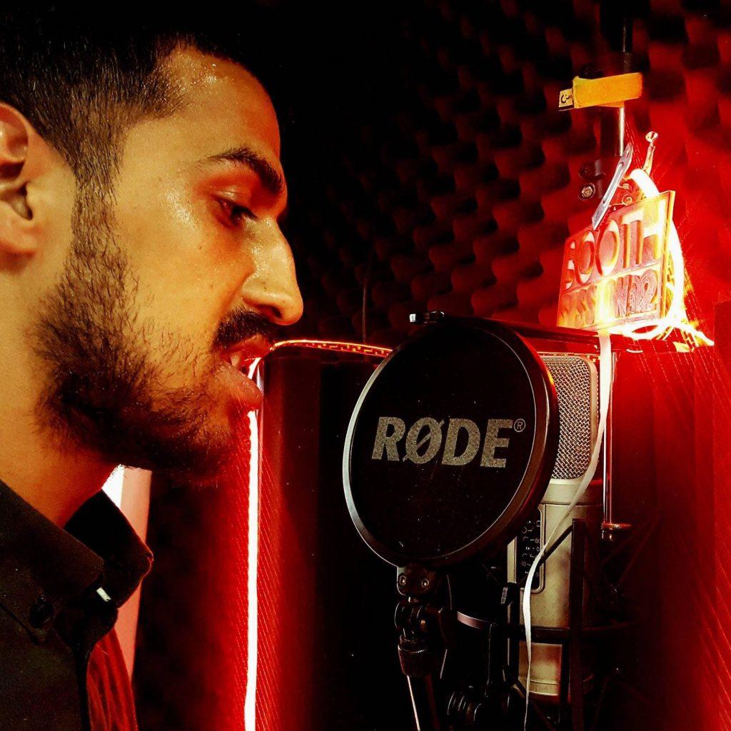 man singing into mic
