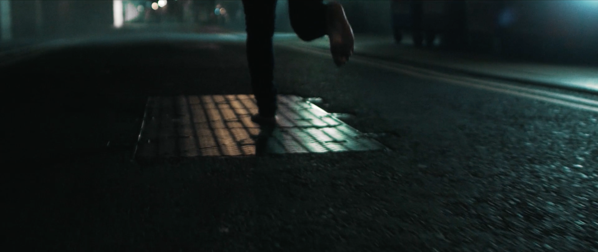 Image of running in the street from the film